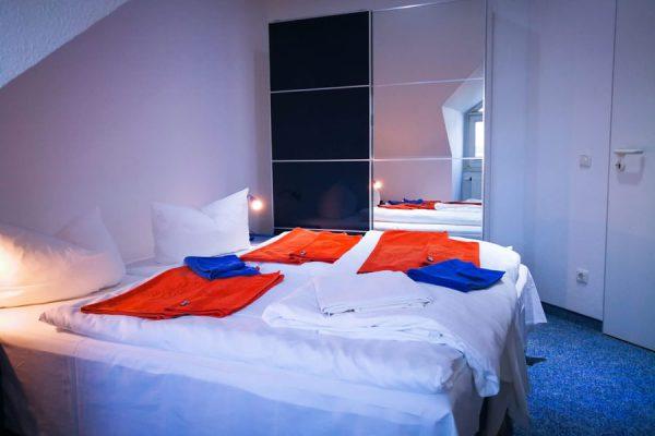 Schlafzimmer 4-Raum-Ferienwohnung im Osteebad Binz auf Rügen
